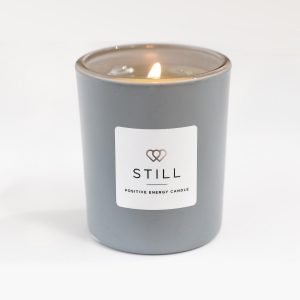 Positive Energy Mini Candle STILL in Matt Grey 9cl with wick lit - The Universal Soul Company