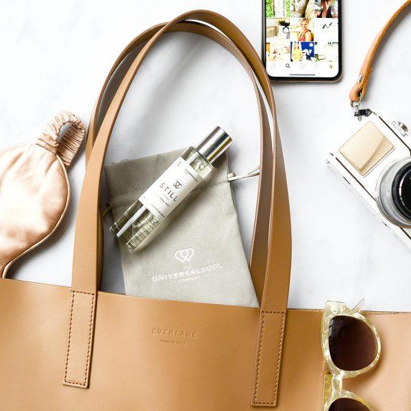 3-IN-1 SOUL MIST STILL TRAVEL SIZE PILLOW MIST & ROOM SPRAY WITH VELVET BAG - Lifestyle shot leather handbag
