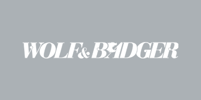 Wolf & Badger Stockist Logo - The Universal Soul Company